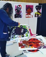 Honey Williams installing the exhibition
